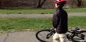 A boy tries his new bike